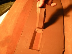 Beveled opening in clay slab